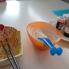 Paintbrushes & water, cornstarch and gel food colouring - a few tools of the trade